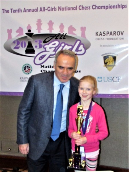 GM Gary Kasparov awards Alexis her trophy